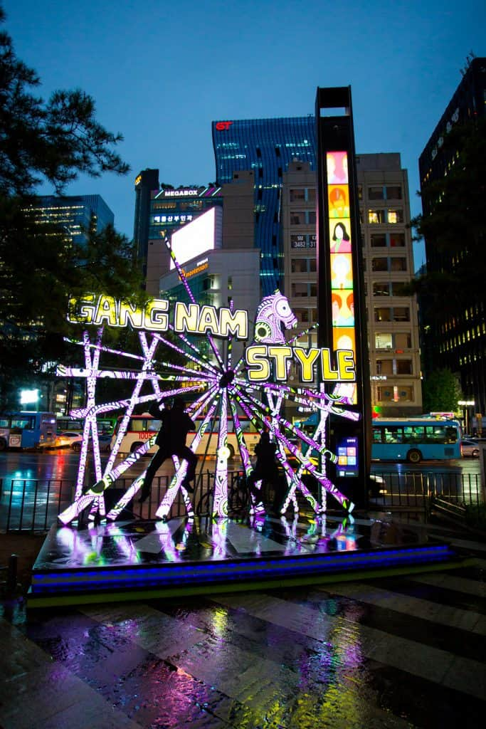 Gangnam Style sign lit up at night near Gangnam Station in Seoul, South Korea