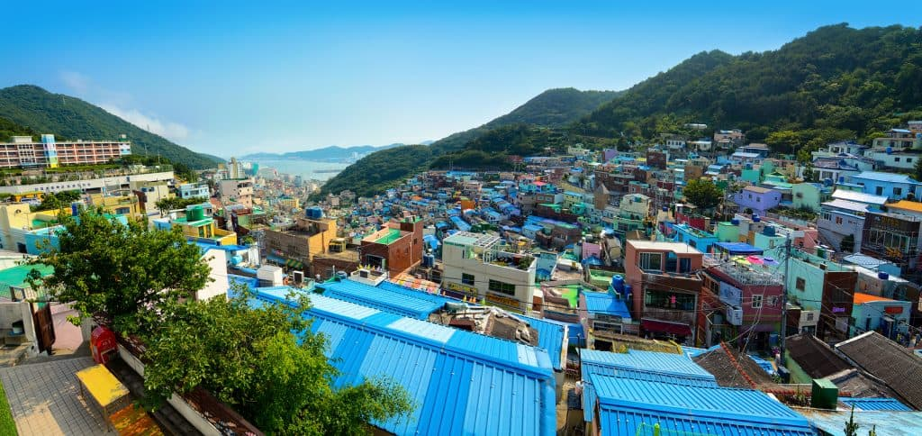 Gamcheon Cultural Village in Busan, Korea, with mountains in the background