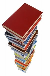 Large stack of books piled up