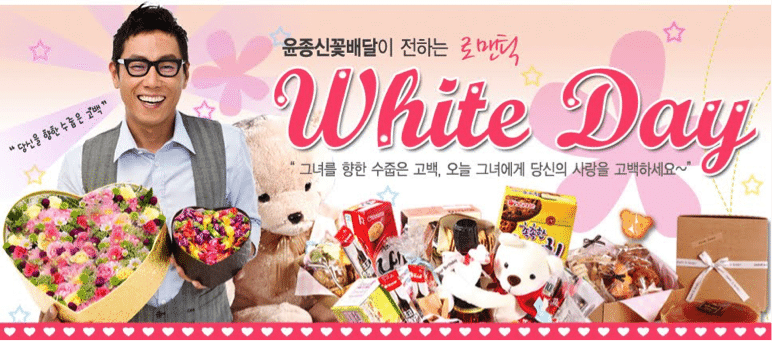 Man with glasses and white shirt smiling about White Day in Korea