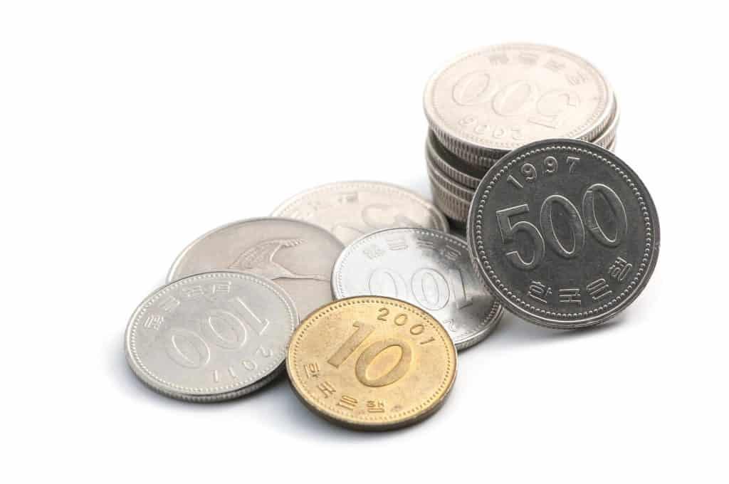 A pile of various Korean coins