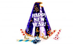 a happy new years hat with some noise makers on a white background