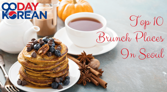 Delicious brunch with blueberry pancakes and tea on a grey table