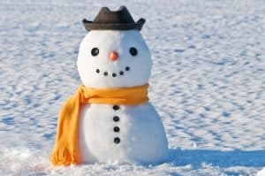 Snowman wearing a yellow scarf and a grey hat