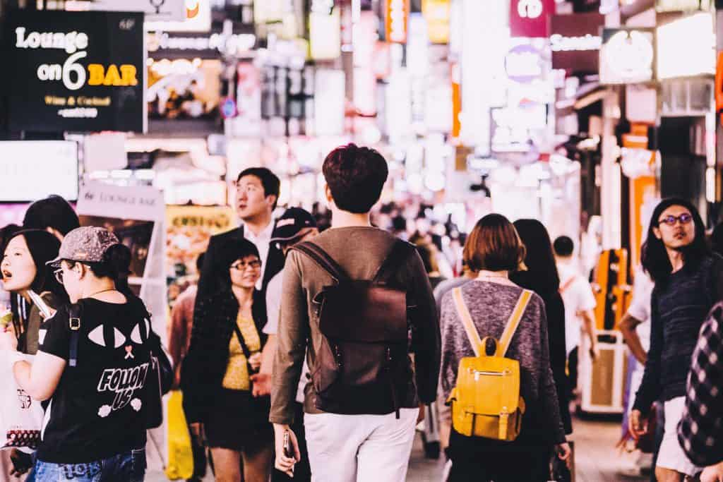 People walking around on a busy street in Seoul, Korea