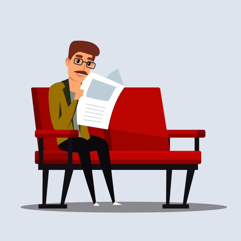 Man with eyeglasses sitting on a couch while reading newspaper