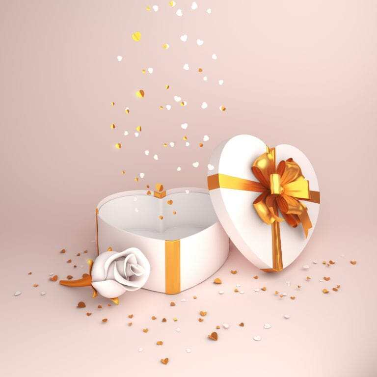 This photo has white rose flower heart shape gift box and gold confetti glitters