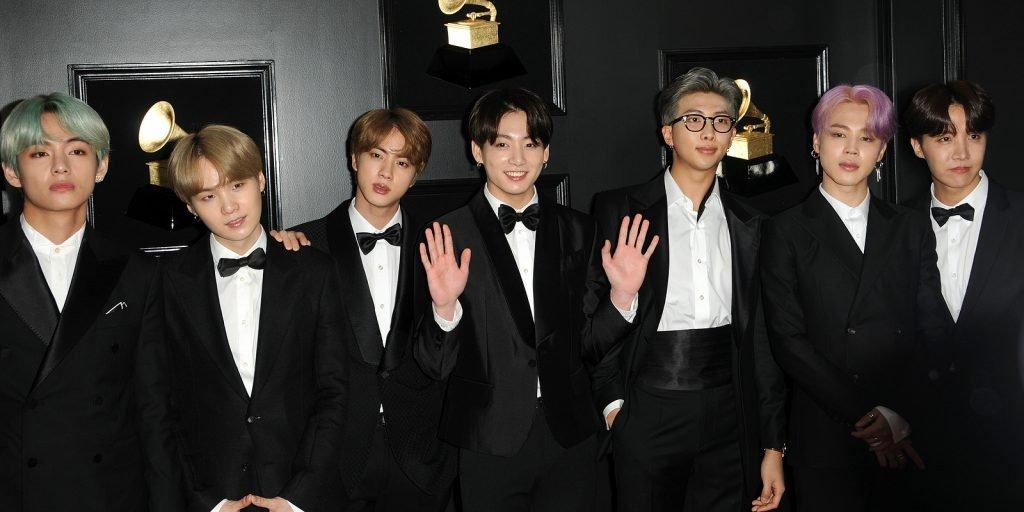 7 men wearing black tuxedo