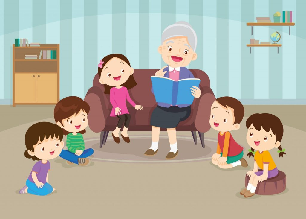 Grandmother seated on a sofa while reading stories to her grandchildren