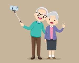 An old man and old lady taking a selfie with a selfie stick