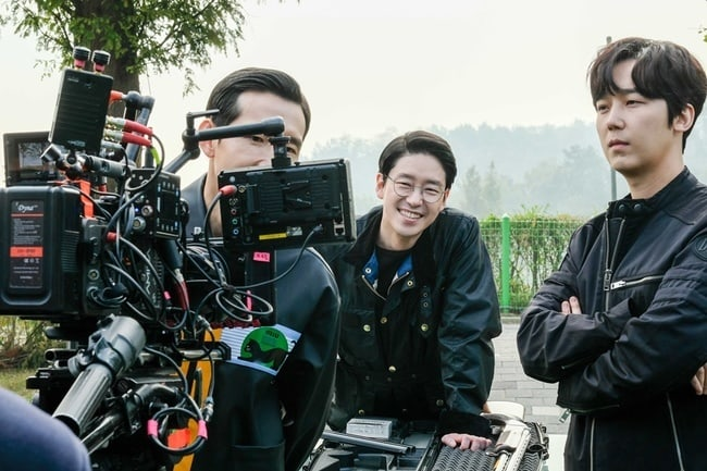 actors looking at a video camera